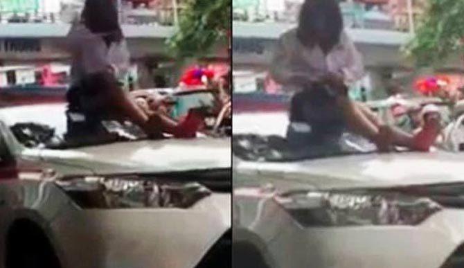 Bị bắt lỗi vượt đèn đỏ, nữ tài xế trèo lên nóc xe lăng mạ CSGT