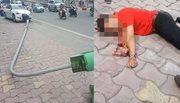 Audi húc đổ cột đèn trúng người đi bộ trên phố Hà Nội