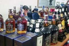 Kho rượu ngoại hàng chục nghìn chai, nghi vấn dùng tem giả