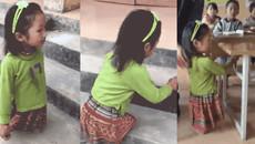 Khâm phục cảnh bé gái cụt 2 chân vẫn lạc quan đến lớp