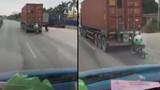 Núp sau container tránh rét, thanh niên lái xe 1 tay nhận cái kết lạnh ngắt
