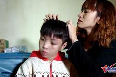 Bé trai bị bố và mẹ kế đánh rạn sọ não xin tha cho bố