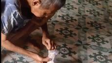 Cụ ông cất tiền kỹ nhất Việt Nam: Bọc chục lớp nilon, buộc trăm sợi dây thun