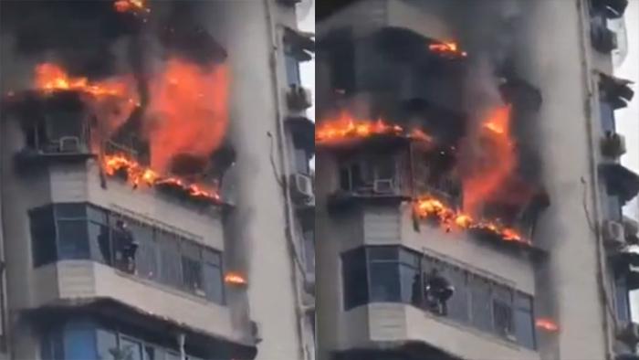 Phút sinh tử đu mình trên ban công cao tầng cháy ngùn ngụt