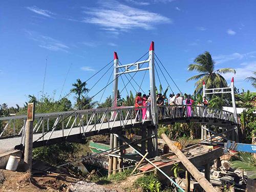 Những cây cầu mang Tết sớm cho quê nghèo miền Tây