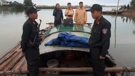 Nổ súng khống chế ghe máy chở gỗ lậu trên sông