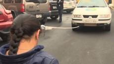 Thiếu nữ 16 tuổi dùng tóc để kéo xe nặng 2 tấn